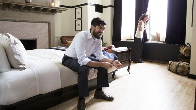 Couple In Hotel Guestroom