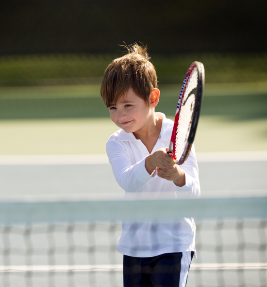 Carmel Valley Ranch_Activities_Tennis_boy playing junior tennis camp