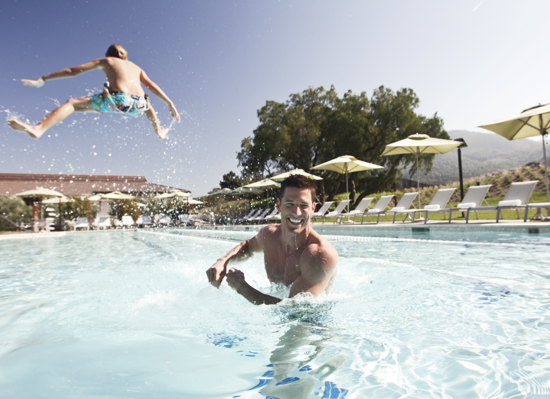 Carmel Valley Ranch_Lifestyle_Play_dad in pool with jumping kid