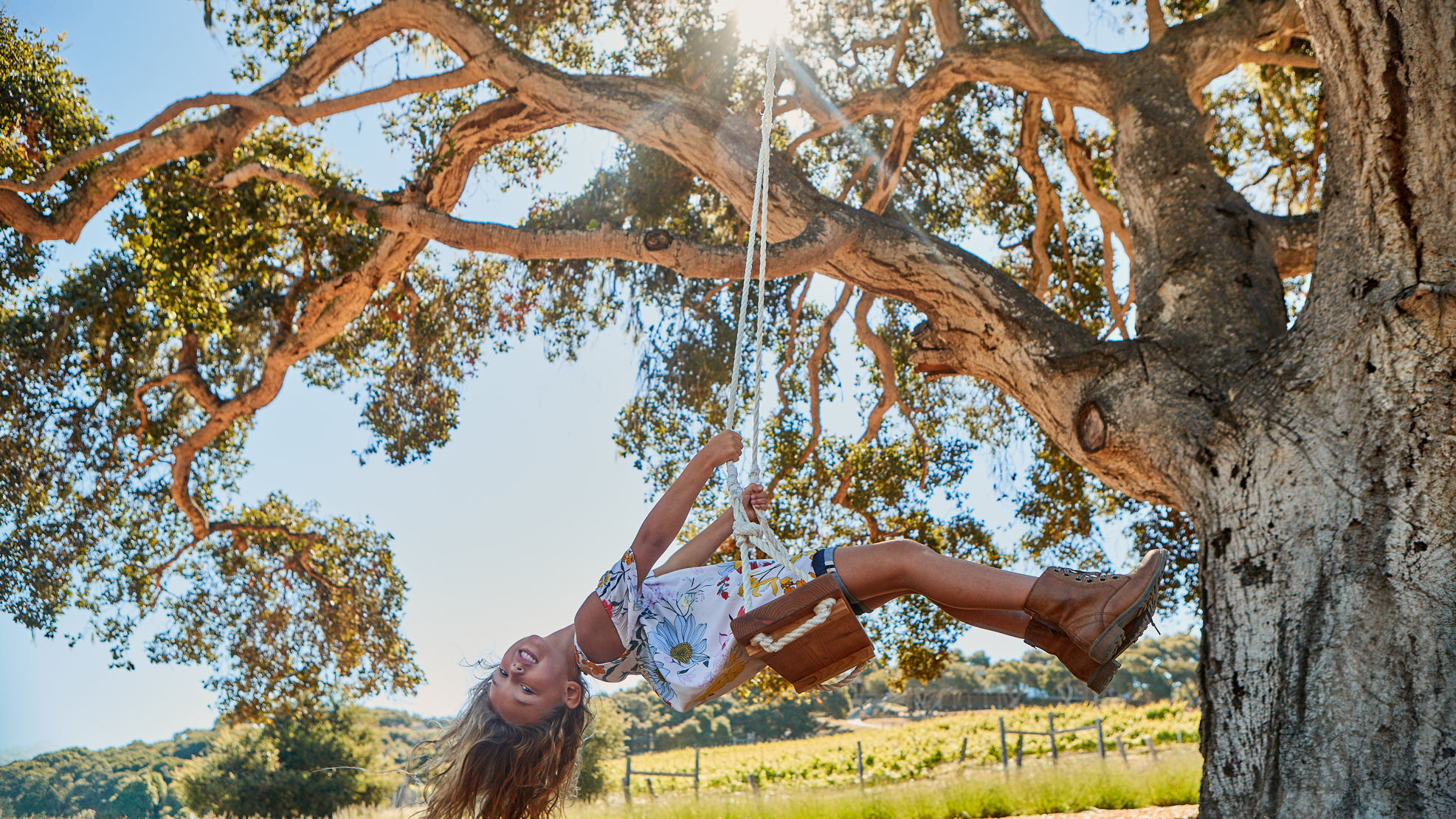 Carmel Valley Ranch_Lifestyle_Play_girl on swing_hair down_2296_GJ