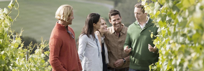 Carmel Valley Ranch_Lifestyle_vineyard walk with friends vertical