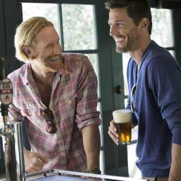 Carmel Valley Ranch_Lifestyle_Play_guys drinking beer at bar at River Ranch