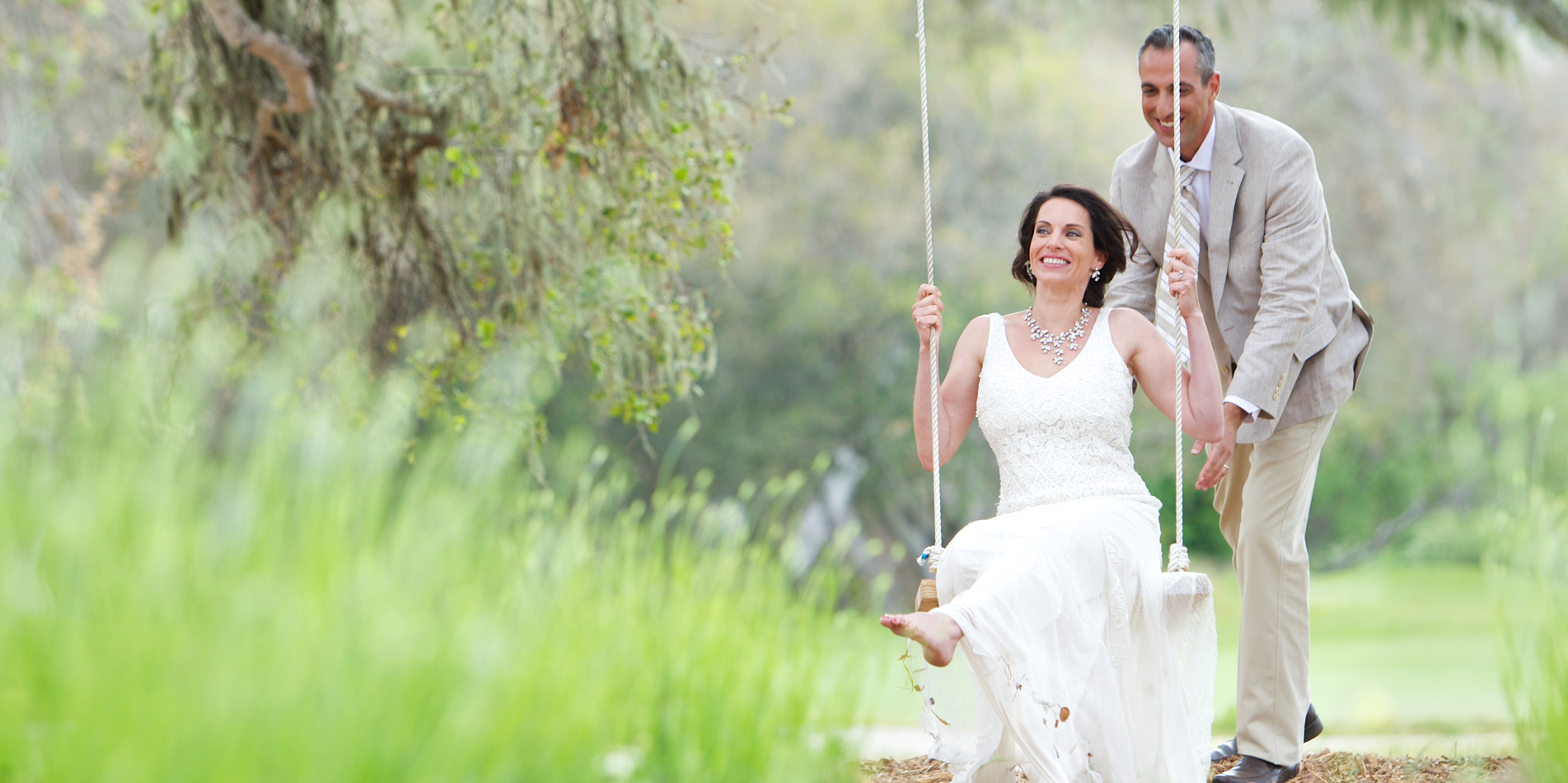 Carmel Valley Ranch_Weddigns_Swing_bride and groom fun swinging