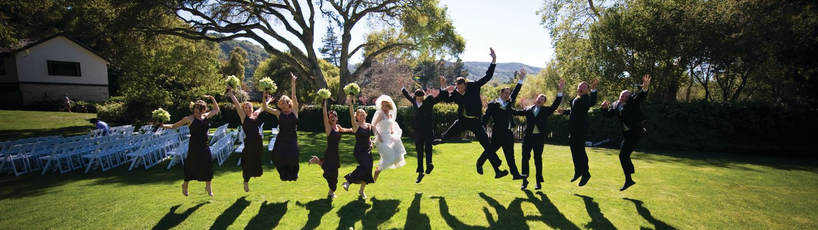 Carmel Valley Ranch_Weddings_bridal party jumping on River Ranch lawn