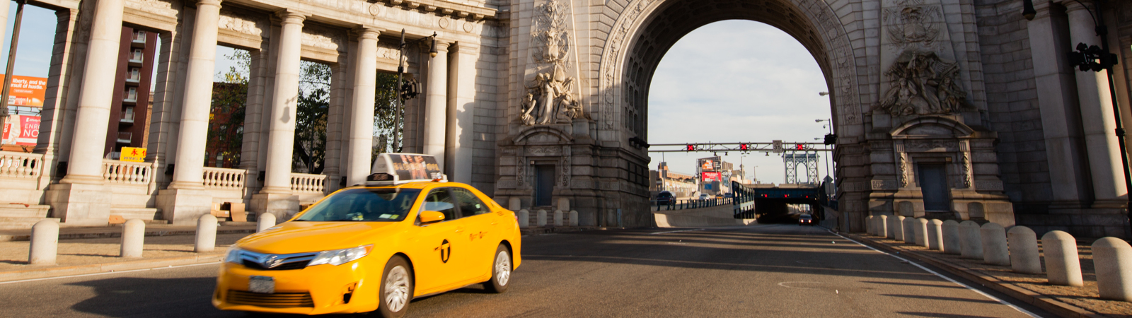 Taxi In Front Of Manhattan Bridge Archway
