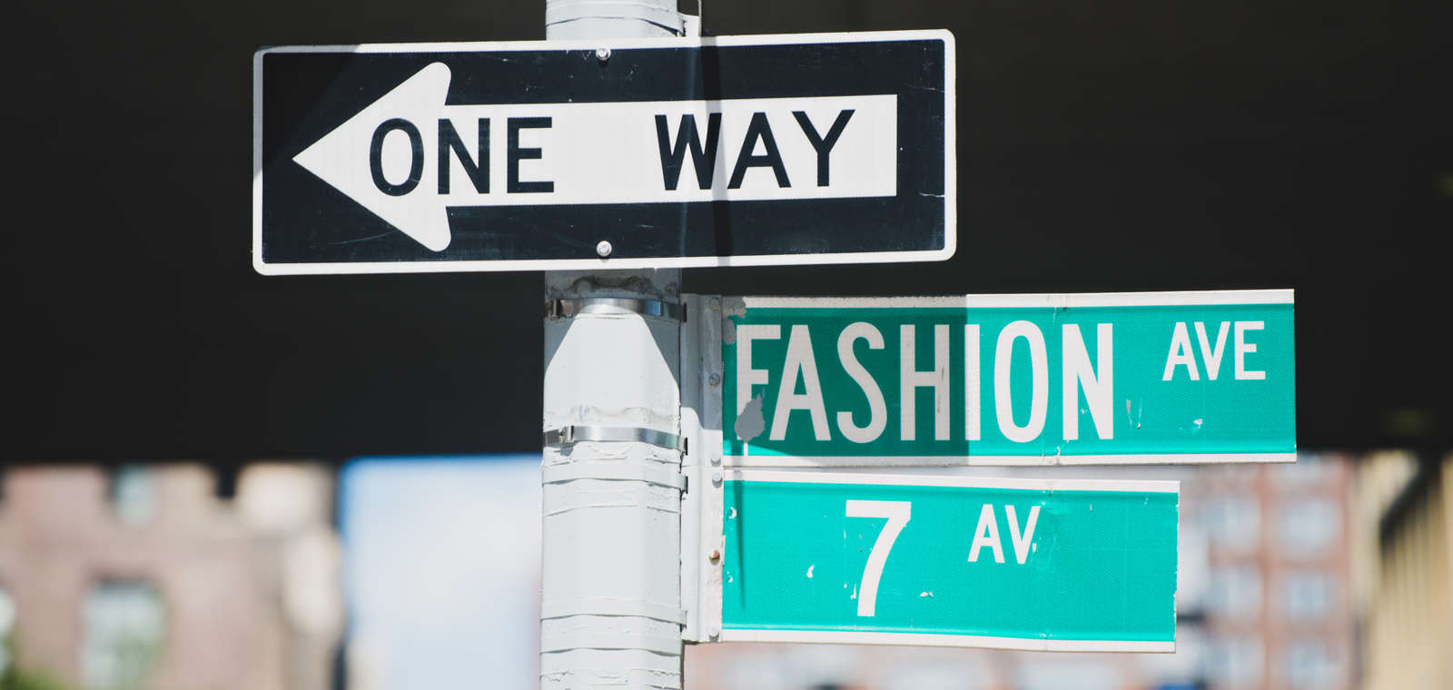 Street signs for Fashion Ave and & Ave in NYC