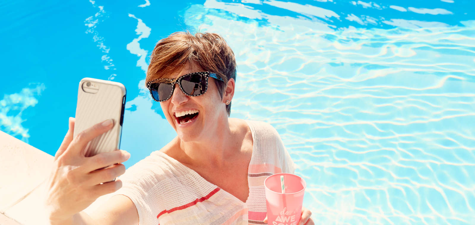 Woman Taking Selfie By Pool