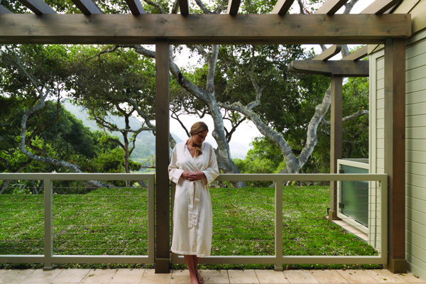 Woman Standing Outside of Spa