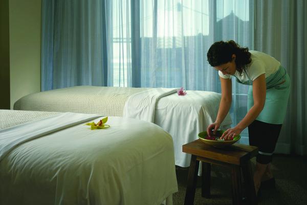 Woman Setting Up Massage Room