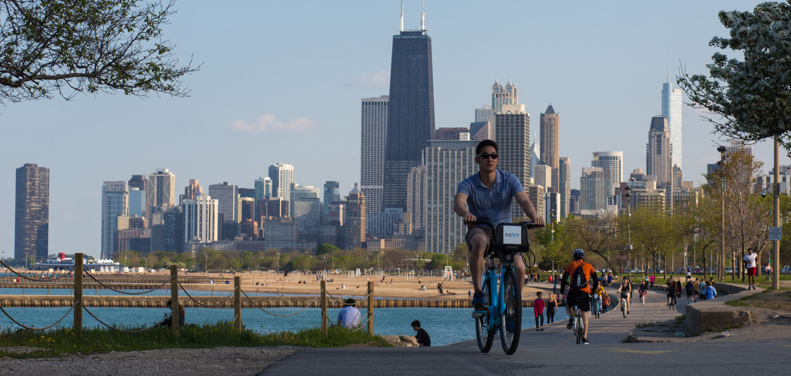 People Biking Along Lake Michigan