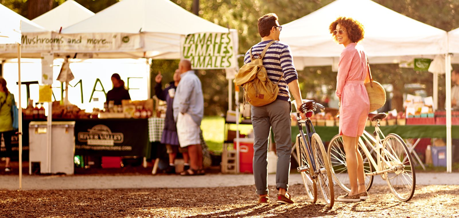 People With Bikes At Farmers Market