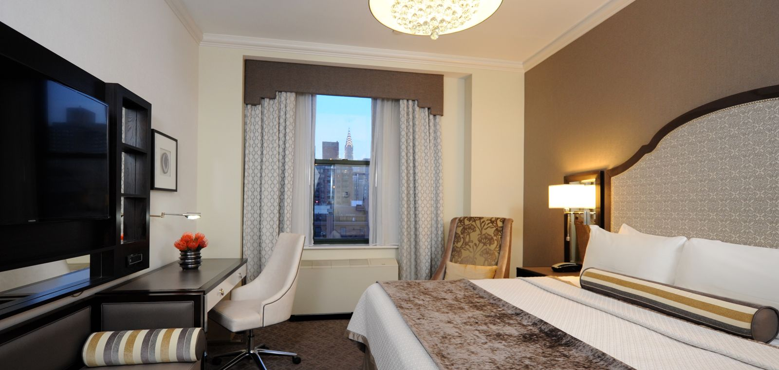 Bed And Desk In Executive Guestroom