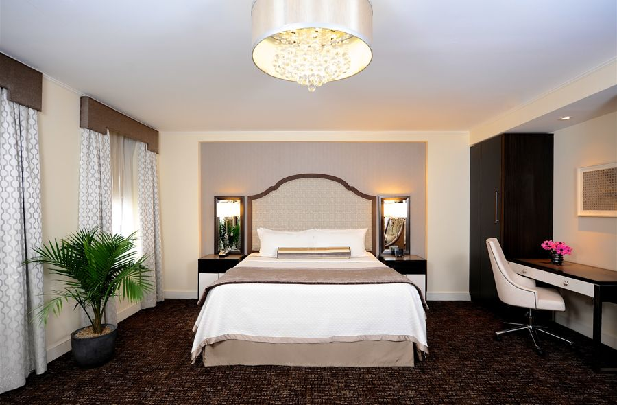 Bed And Desk In Junior Suite