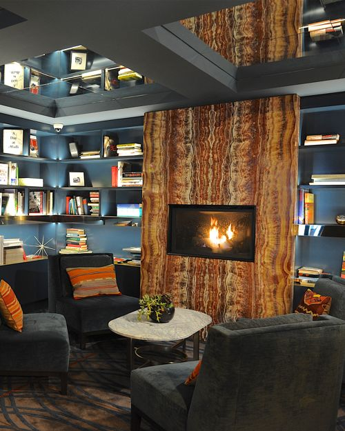 Sitting Area With Books And Fireplace