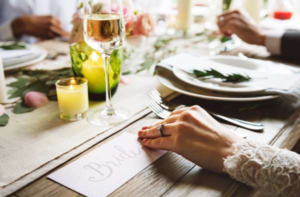 Bride Holding Card