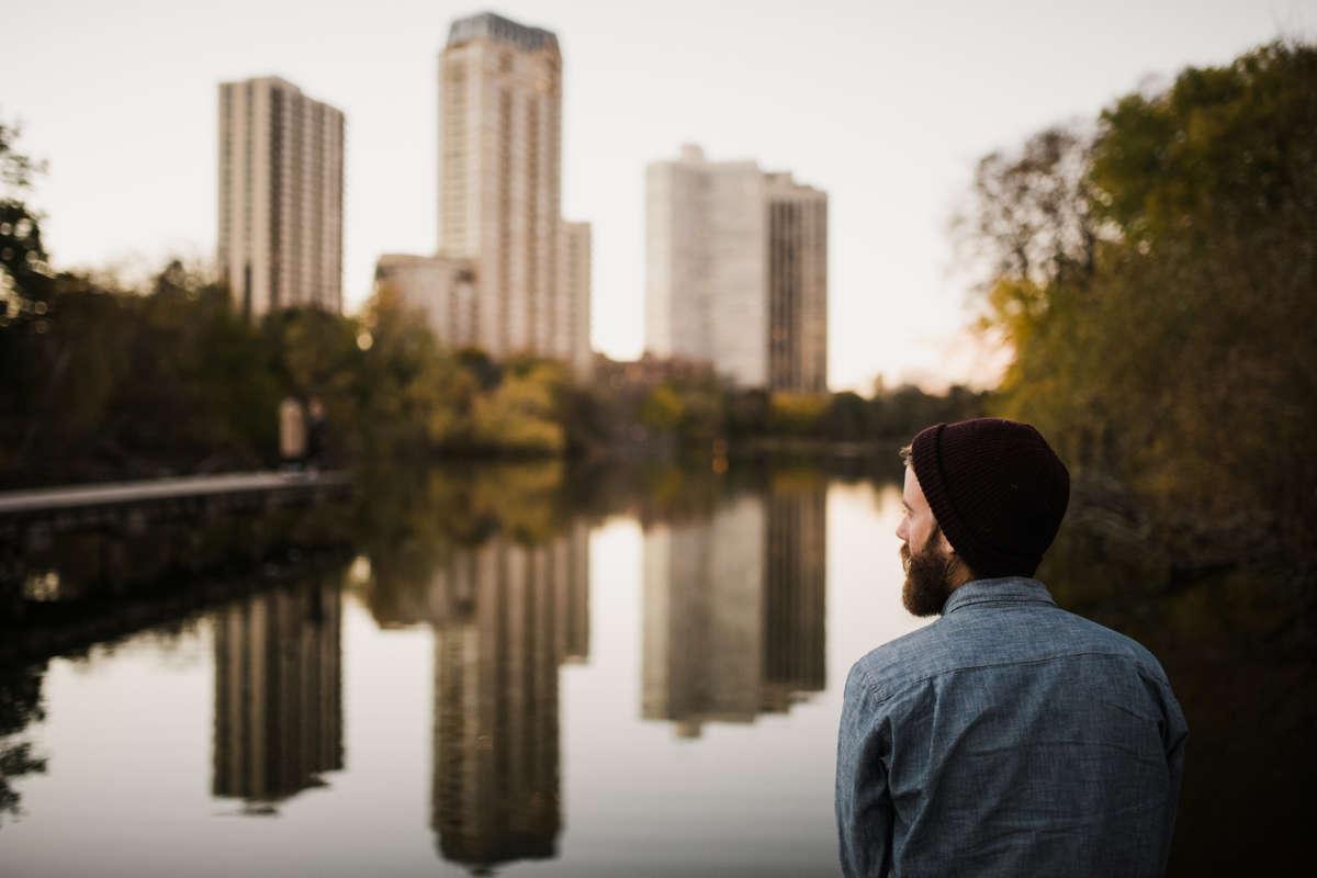 Man gazing at river.