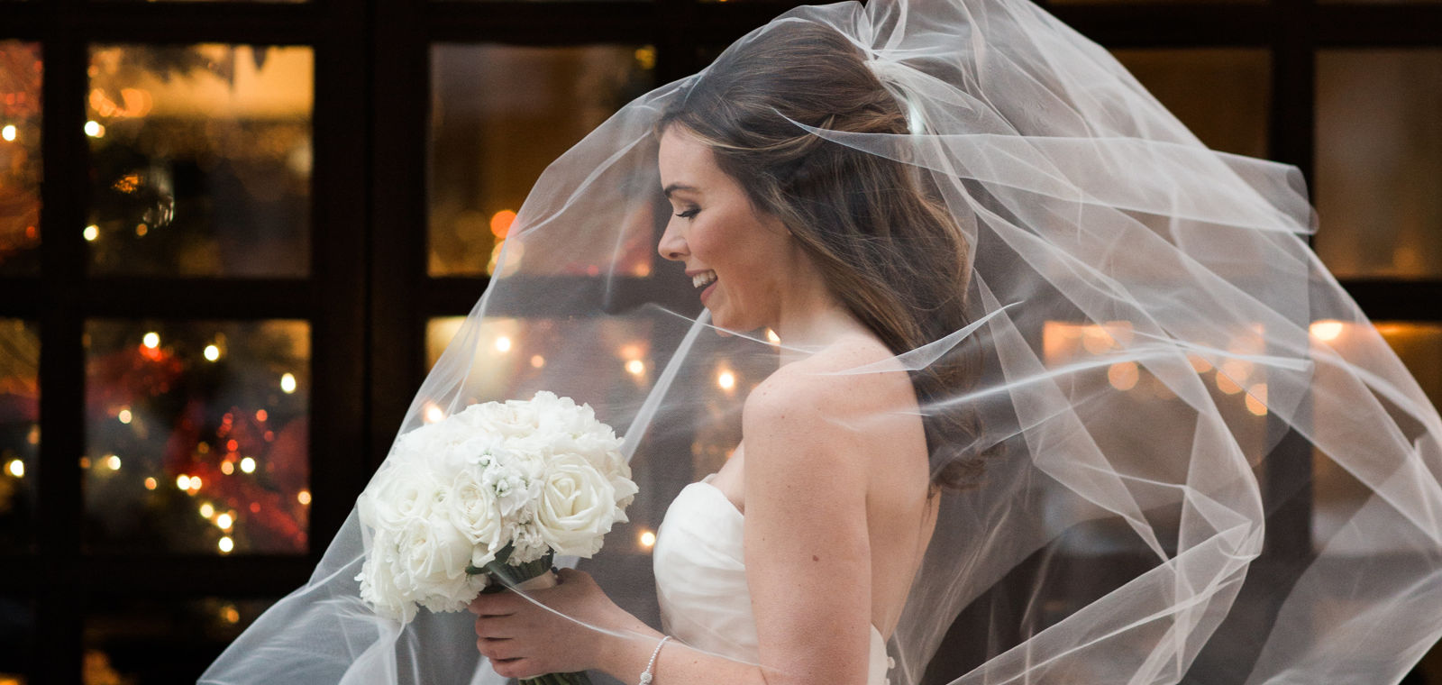 Talbott Hotel_Weddings_Bride Walking with Veil in Air