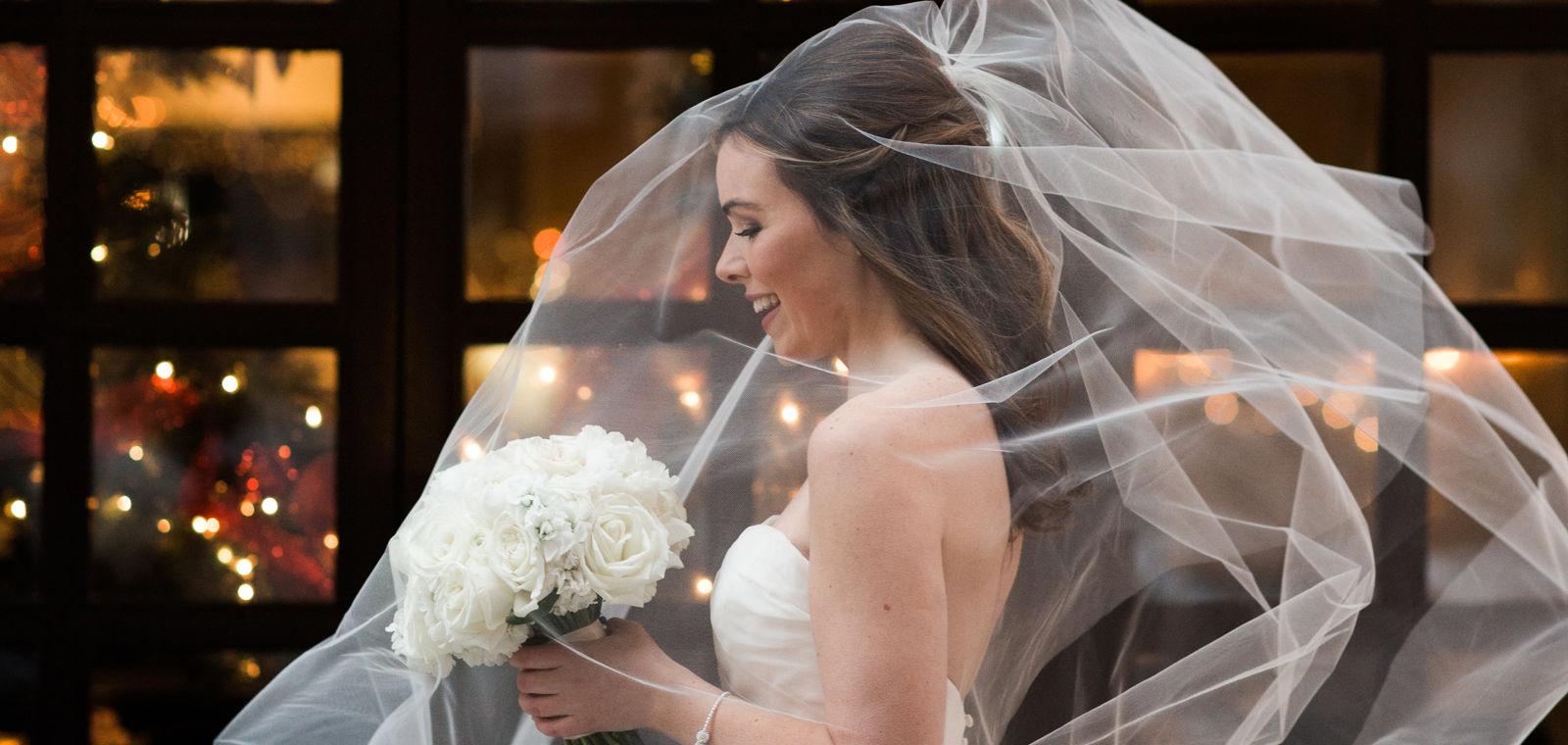 Talbott Hotel_Weddings_Bride Walking with Veil in Air