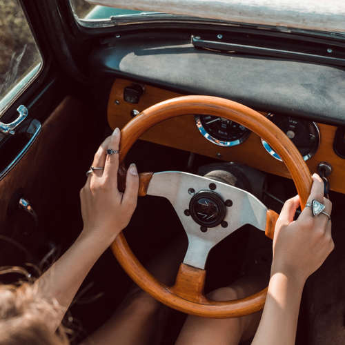 Woman Driving Vintage Car