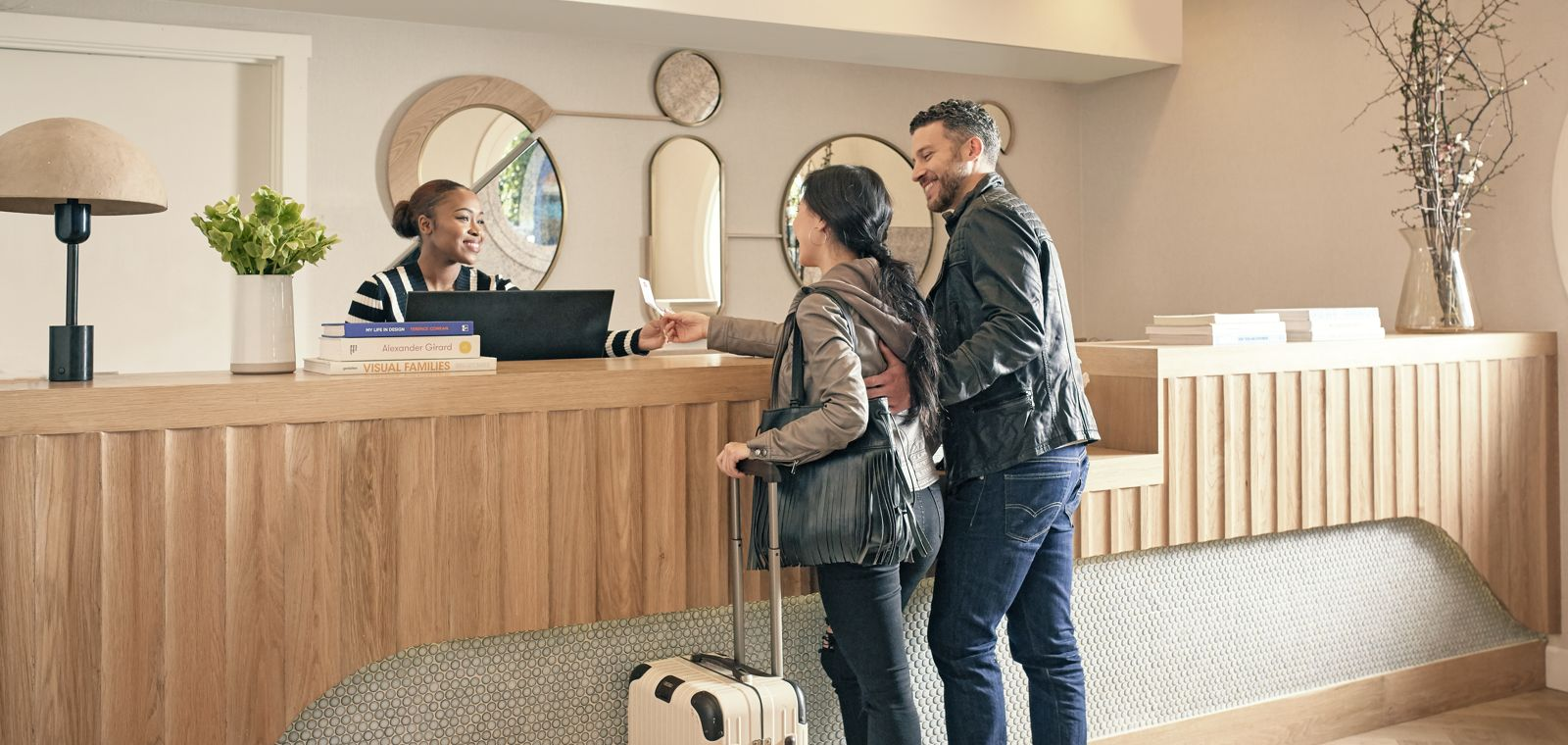 Waterfront-Hotel-couple-checking-in-lobby-Lifestyle